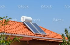 Solar water heating panel and water collector on a house roof